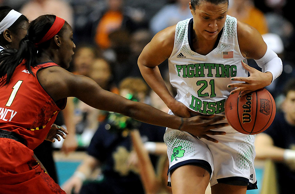 Notre Dame Fighting Irish guard Kayla McBride (21) drives up court as Maryland Terrapins guard Laurin Mincy (1) reaches in for the ball during the first half of the 2014 NCAA Women's Final Four in Nashville, TN., Sunday night. McBride scored 28 points and Notre Dame easily advanced with an 87-61 victory.