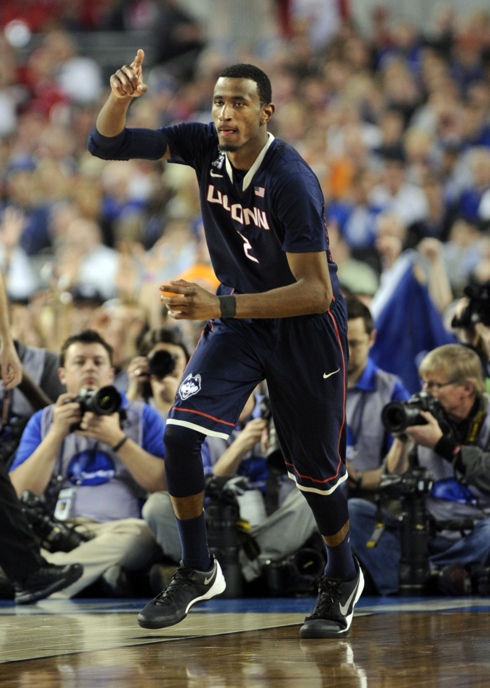 DeAndre Daniels signals #1 after scoring a 3-pointer in the 2nd half as UConn pulled ahead.