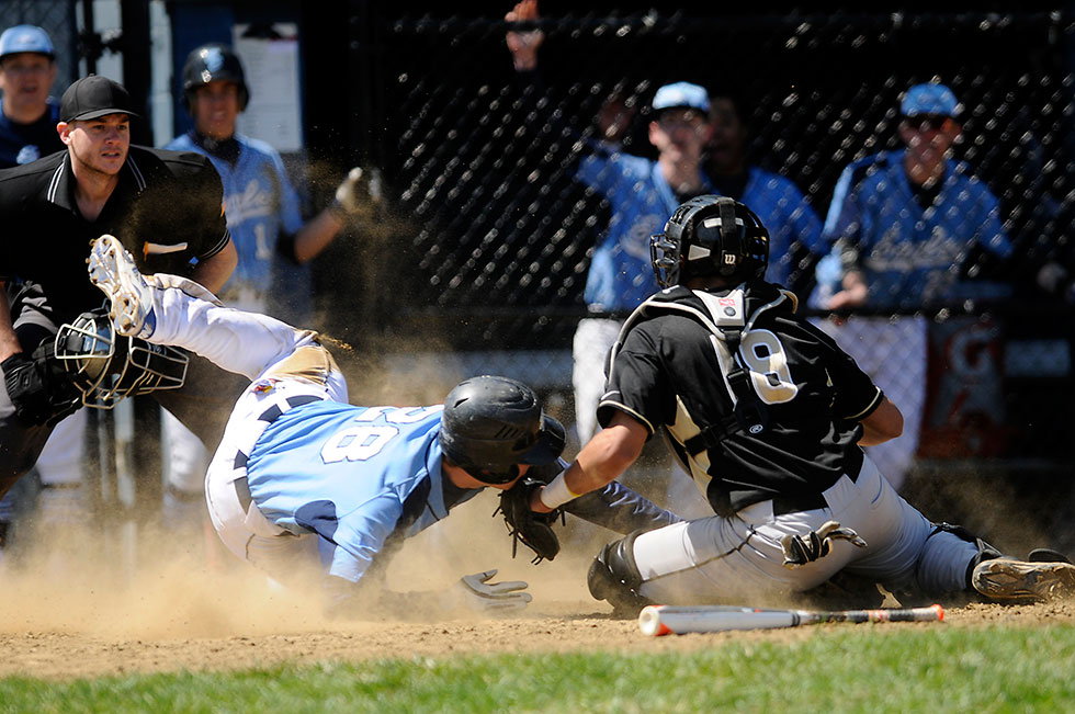 Christian Caballero of East Hartford puts the tag on Josh Zbierski of East Catholic at the plate as he tried to score from second base during their baseball game Thursday afternoon. East Hartford held on for a 4-3 victory.
