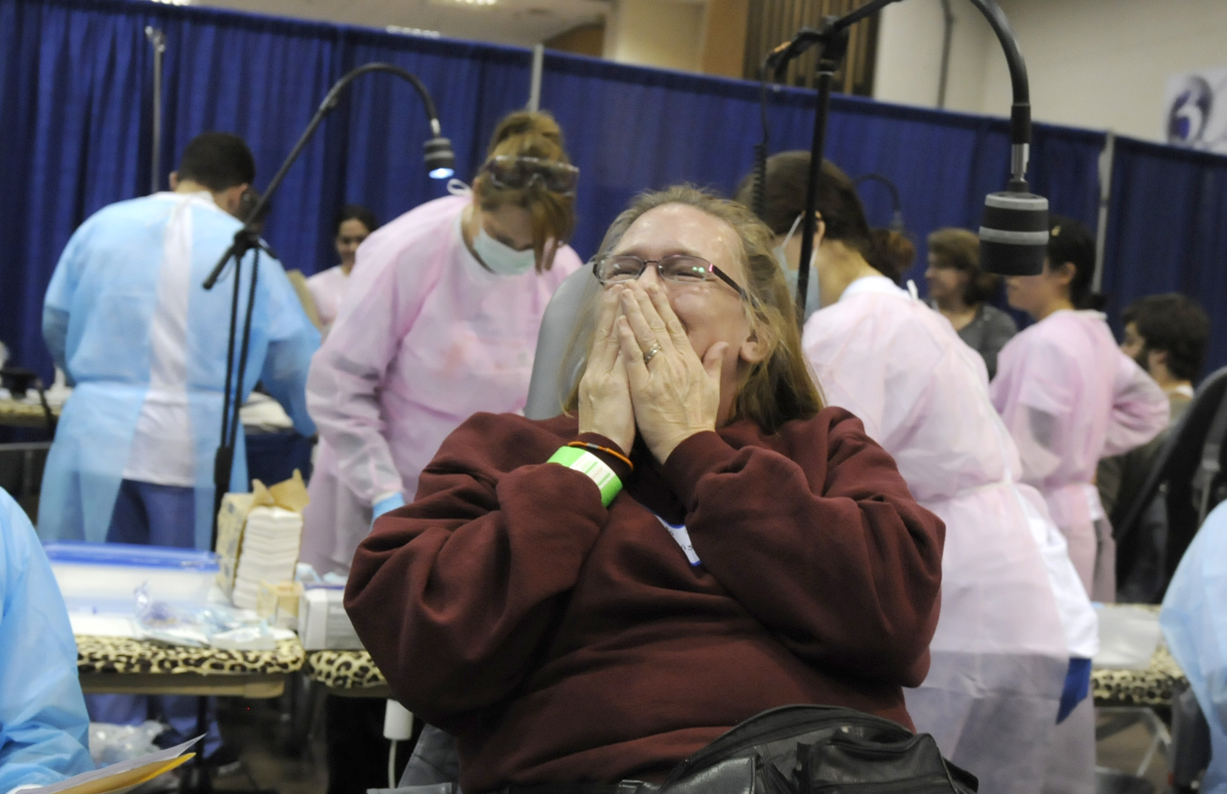 Brenda Davis, of Plymouth, blows a kiss to staff after getting a tooth extracted. She and hundreds of others were in line early Friday seeking free dental care staffed by volunteer dentists and assistants in a makeshift clinic. The CT MOM Free Dental Clinic at the XL Center in Hartford offered a full range of dental services on a first come first served basis starting at 6 A.M. Friday. More than 700 walked through the doors four hours later. The clinic continues Saturday.