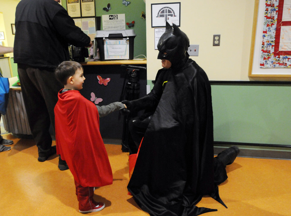 Super hero Ian Fagan, 5, of Hebron, left, a patient at Connecticut Children's Medical Center, meets Batman, portrayed by Jim Grady, of New York, at the medical center Monday.