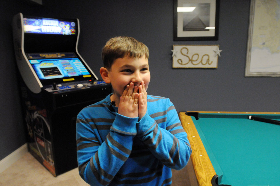 Andrew Hedberg, 9, of Southington, who is battling bone cancer, had his recreation room at his Southington home renovated by Make-A-Wish. The finished room, which was done in a nautical theme, was revealed to him for the first time Tuesday evening.