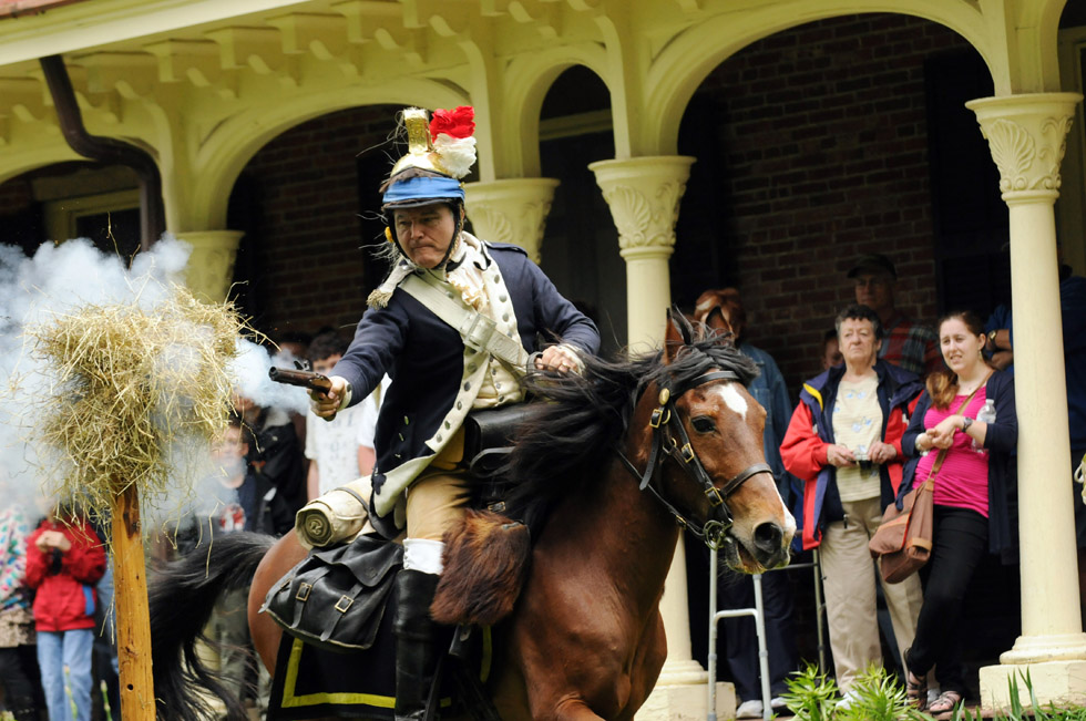 Captain Sal Tarantino, of Colchester, leader of the Sheldon's Horse, Second Continental Light Dragoons, demonstates firing a pistol on horseback during the sixth annual Revolutionary War Encampment at the Webb-Deane-Stevens (WDS) Museum in Old Wethersfield  Saturday.