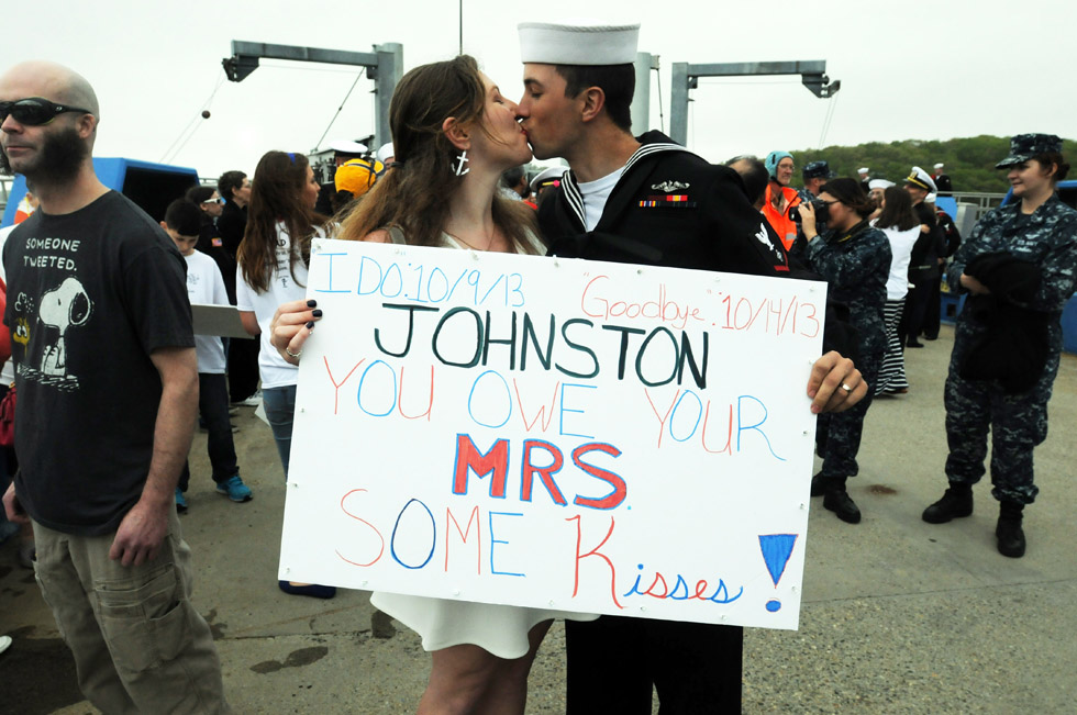 Posing for a portrait, Marina and Chris Johnston, of New London, hold her sign and kiss upon his return from a seven month deployment Friday. The Los Angeles-class attack submarine USS San Juan returned to Connecticut Friday, May 16. San Juan's crew of more than 140 Sailors departed Naval Submarine Base New London Oct. 15 to conduct maritime operations in the Middle East and Europe. The submarine visited ports in Bahrain, the United Arab Emirates, Portugal and Spain while deployed.  Three newborns met  their dads for the first time Friday. San Juan was commissioned in August 1988. The 25-year-old vessel is the third U.S. Navy ship named for Puerto Rico's capital city.