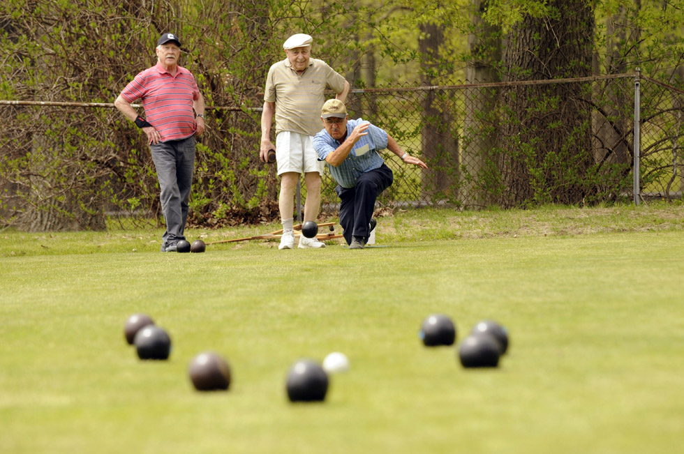 Jack Miller, of West Hartford, at center, didn't think he would like lawn bowling. Now he's a pro.