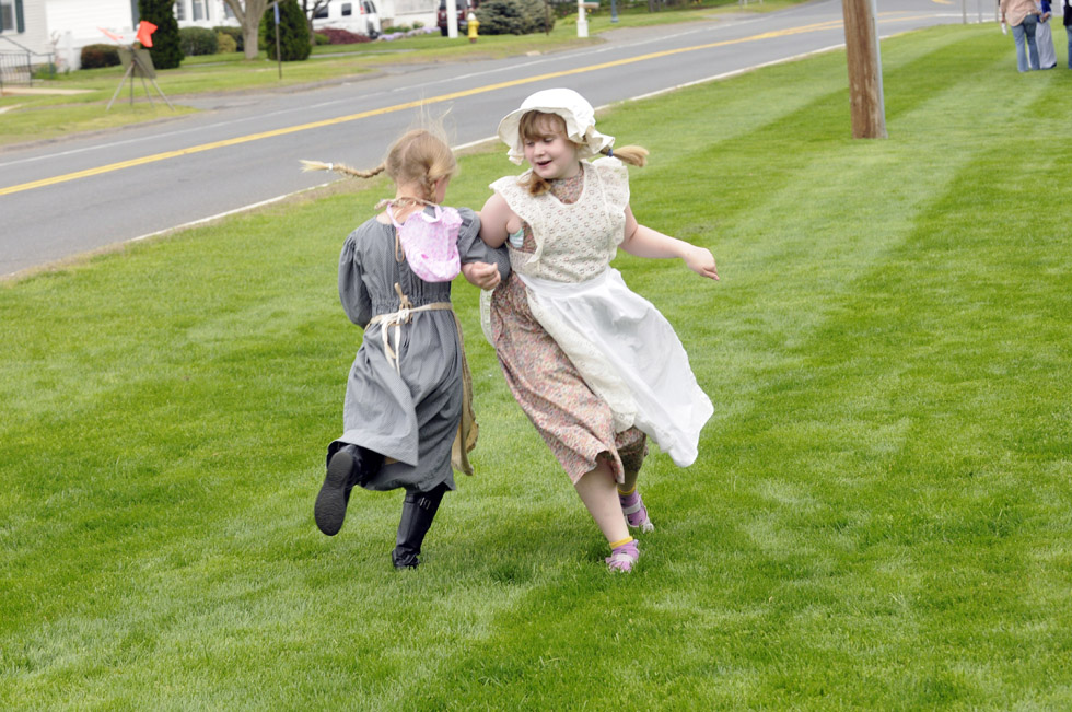 Allison Free, 9, left, and Clara Canavan, 9, both third grade students, dance on the Tolland Green during Tolland Green Day Thursday.