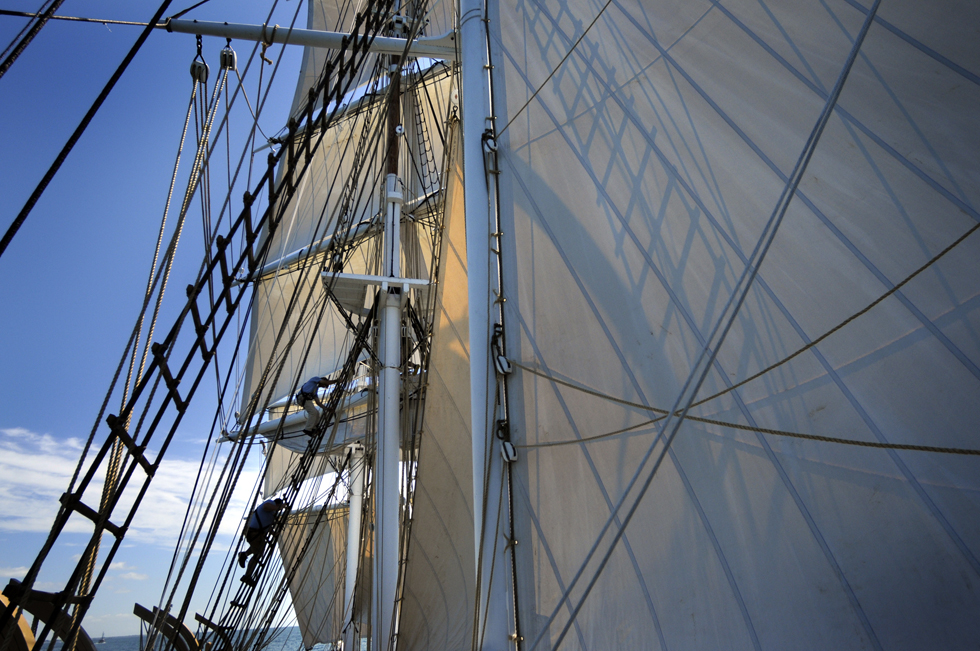 The crew of the  Charles W. Morgan goes aloft to set sails Sunday afternoon during  the ship's first cruise in close to 100 years. As the wind freshened the captain ordered all sails set including the Royal, located at the very top of the mainmast. this is the first time the royal has