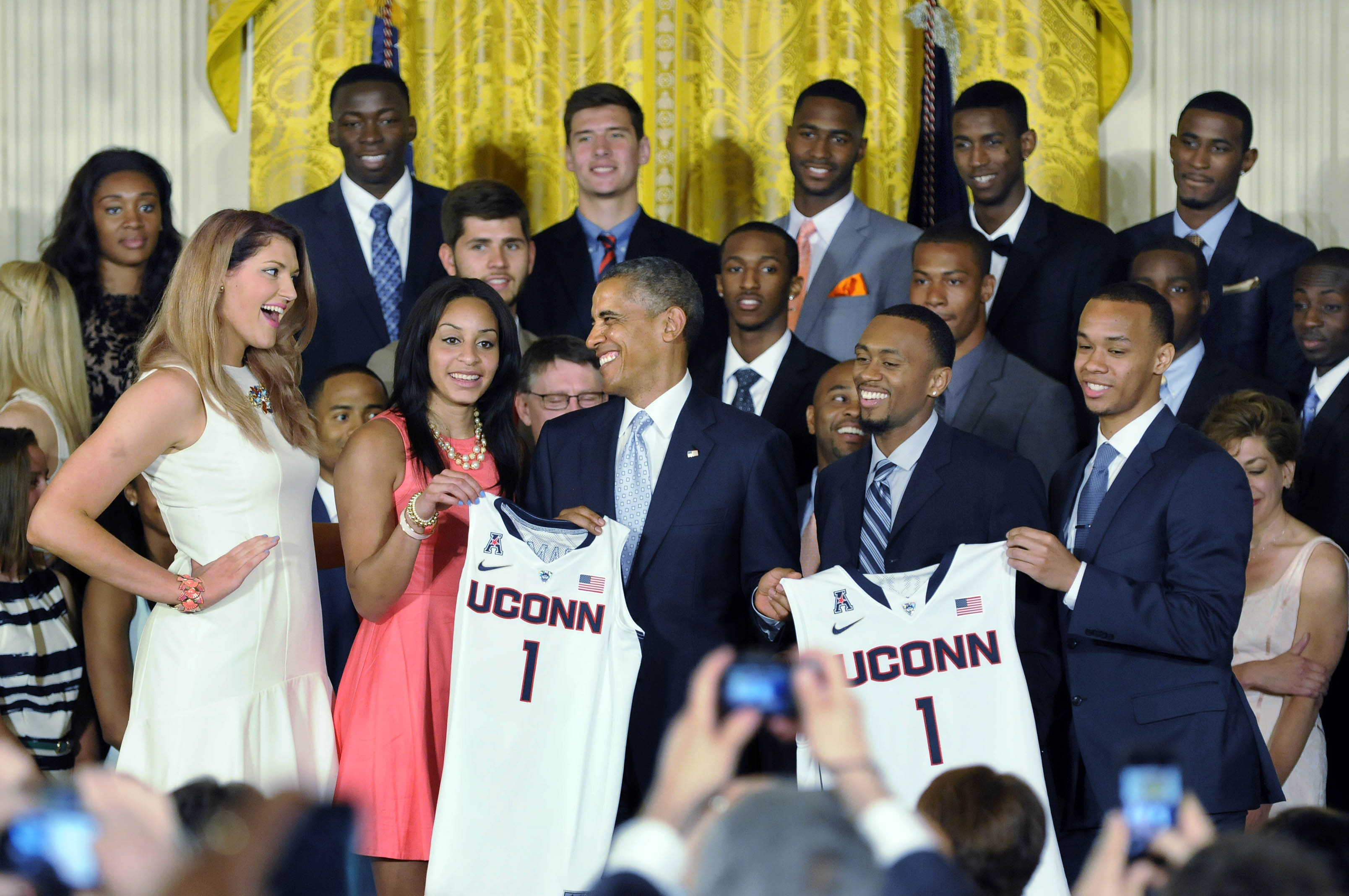 WASHINGTON, DC 06/09/14 President Barack Obama shares a laugh with Stefanie Dolson (left) after he was presented with UConn jerseys during a ceremony honoring the NCAA Champion UConn men's and women's basketball teams in the East Room at the White House Monday afternoon. CLOE POISSON|cpoisson@courant.com