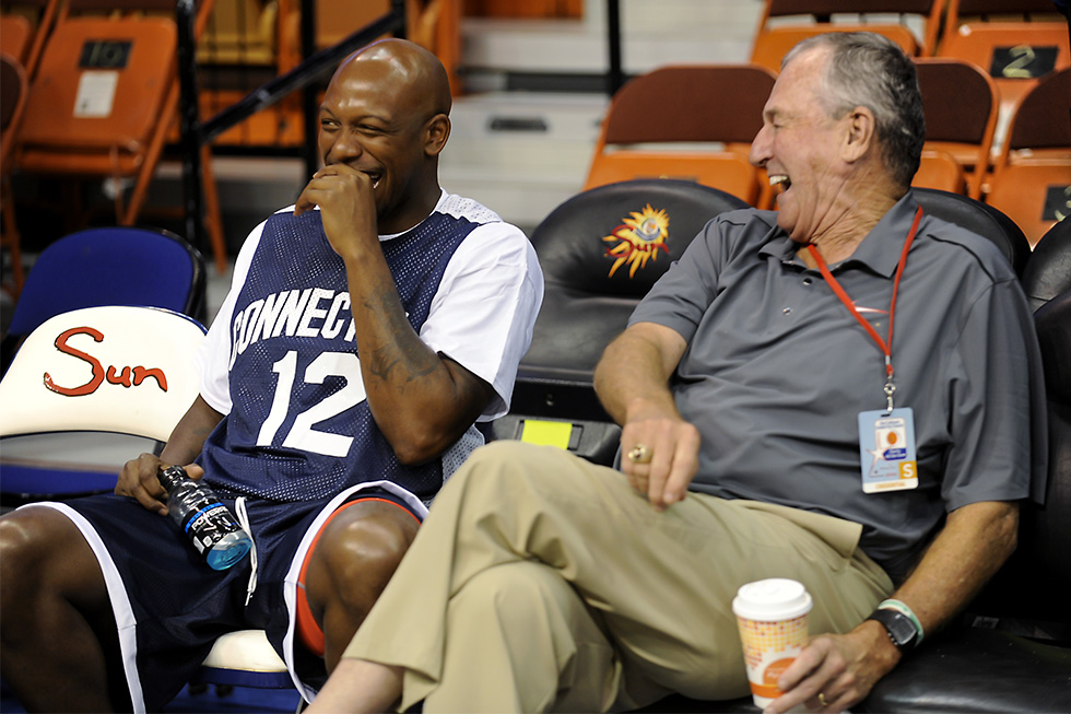 2014.08.08 - Uncasville, CT - Taliek Brown and Jim Calhoun share a laugh as they catch up on the sidelines before the start of Calhouns' Celebrity Classic basketball game at the Mohegan Sun Arena Friday night in Uncasville. Photo by JOHN WOIKE | woike@courant.com