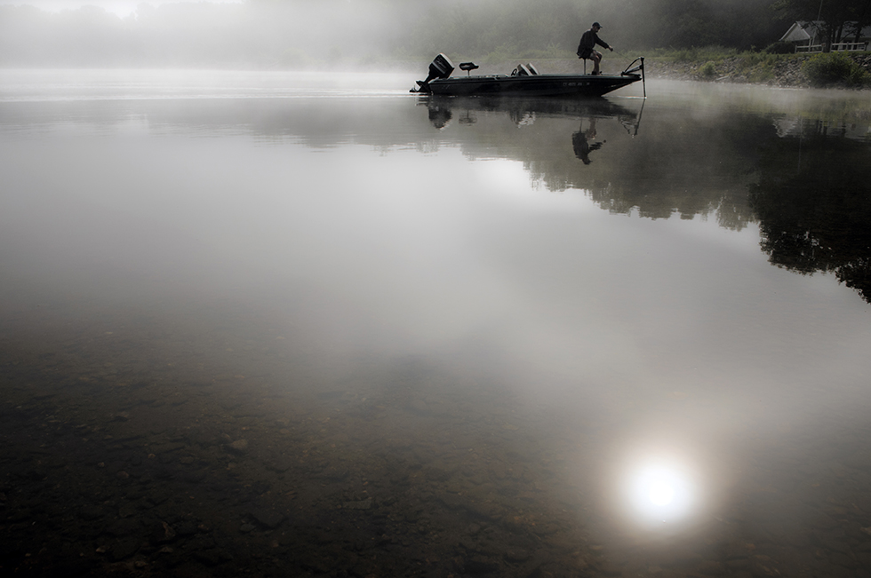 "2014.08.11 - Bolton, Ct. - ""It was pretty surreal out there this morning. You could see about as far as you could cast,"" said Ed Miller, about fishing in the fog this morning on Bolton Lake, ""It was like being in a cloud."" Miller, who said he doesn't fish often enough took a trip out on the lake today after giving himself a day off for his birthday. Photograph by Mark Mirko 