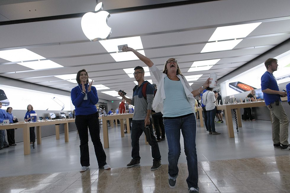 09.19.2014 - Farmington, Ct. - Minutes after the Apple Store in Westfarms opened, Kara McQueeney of Bristol dances out of the store with her new iPhone 6. Photograph by Mark Mirko | mmirko@courant .com