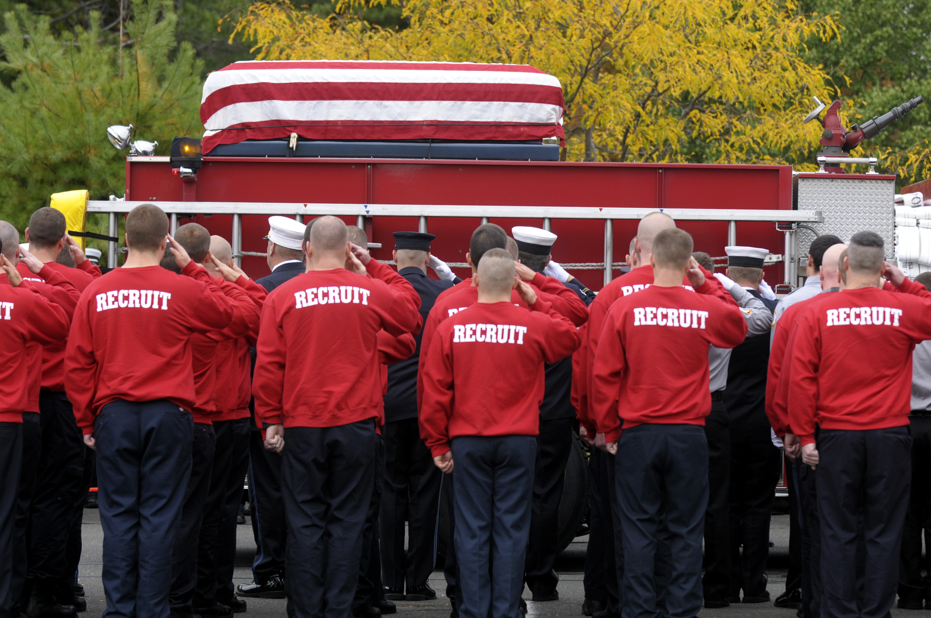 BLOOMFIELD, CT -  10.13.2014  Firefighter recruits from the Connecticut Fire Academy salute the casket of Hartford firefighter Kevin Bell at First Cathedral in Bloomfield. Bell perished in a blaze on Blue Hills Avenue last Tuesday night. Patrick Raycraft |  praycraft@courant.com