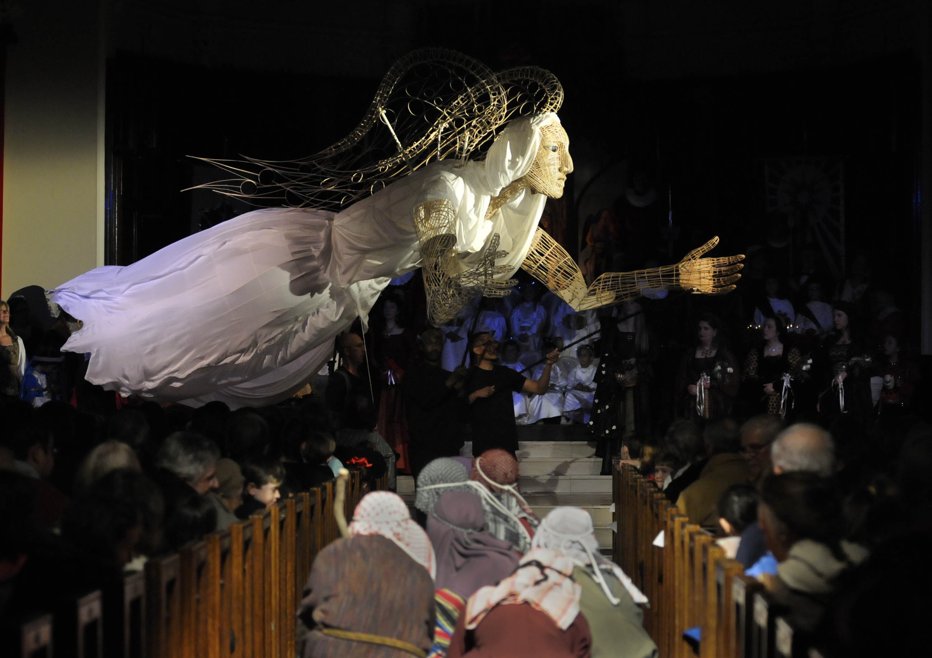HARTFORD 01/11/15 A giant angel puppet created by artist Anne Cubberly, is raised up as the shepherds cower, during the 48th Annual Boar's Head and Yule Log Festival was held at the Asylum Hill Congregational Church Sunday. This is the fourth of five performances this weekend of the celebration of the Epiphany that includes a cast, choir and orchestra of more than 250 people.  CLOE POISSON|cpoisson@courant.com