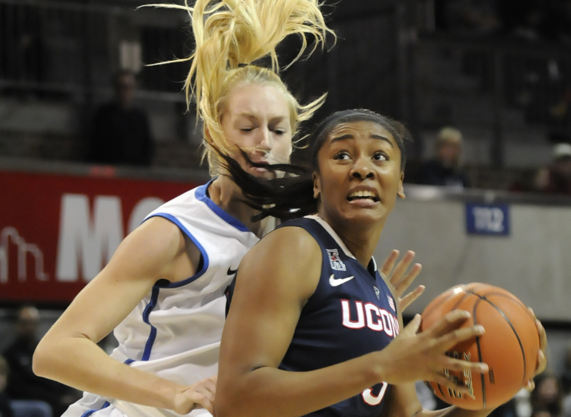Morgan Tuck spins, defended by SMU forward Stephanie Collins in the 1st half.  Tuck added 5 points.