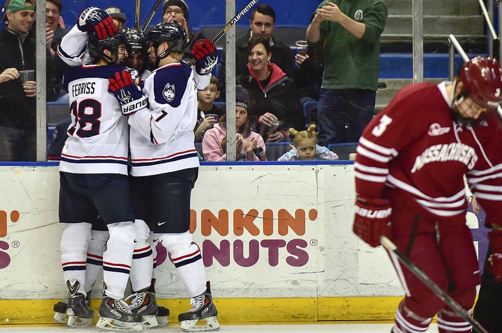 02.20.2015 - Hartford, Ct.  - UConn players (L-R) Joey Ferriss Cody Sharib and Joona Kunnas celebrate a third period goal by Sharib that defeated Massachusetts 4-0. Photograph by Mark Mirko | mmirko@courant.com