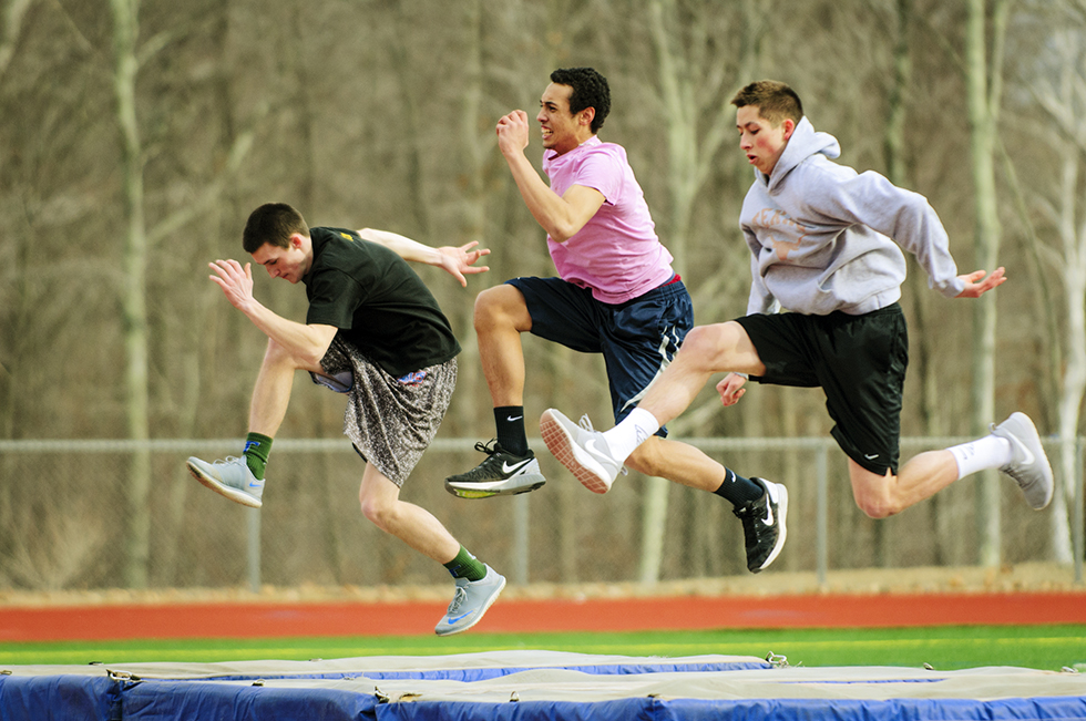 03.31.2015 - Tolland, Ct.  - Tolland High School high jumpers Austin Enman (l-r), Devin Shelton and Wade Allen drill during practice. Photograph by Mark Mirko | mmirko@courant.com