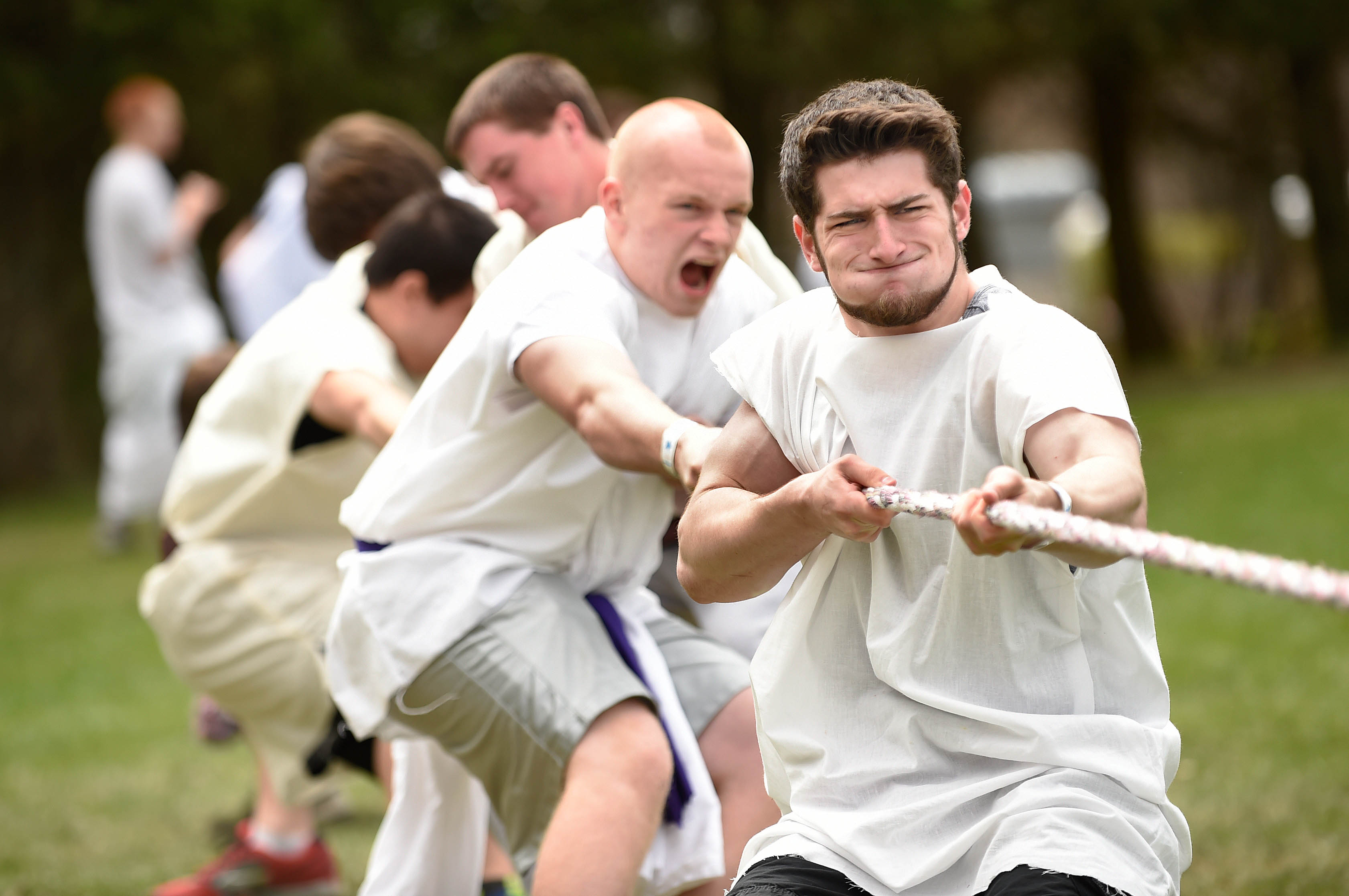 PROSPECT 05/01/15 Dressed in togas, Mark Zebrowski (right) pulls the rope with classmate Luke Devine (second from right) as they fight against Stratford High School in a tug-of war contest at the 34th annual Connecticut State Latin Day at the Holiday Hill resort in Prospect Friday. Latin students from fifty-two middle and high schools across Connecticut competed in academic and athletic contests throughout the day. Rocky Hill won this heat of the tug-of-war.  CLOE POISSON|cpoisson@courant.com