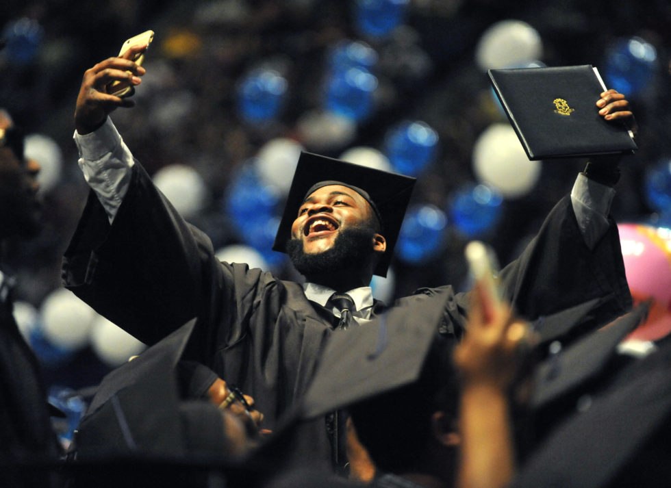 Hartford, CT -  5/16/15 - Graduate William Bostic, of Windsor, takes a dramatic selfie at the conclusion of Central Connecticut State University commencement Saturday at XL Center.  Photo by BRAD HORRIGAN bhorrigan@courant.com