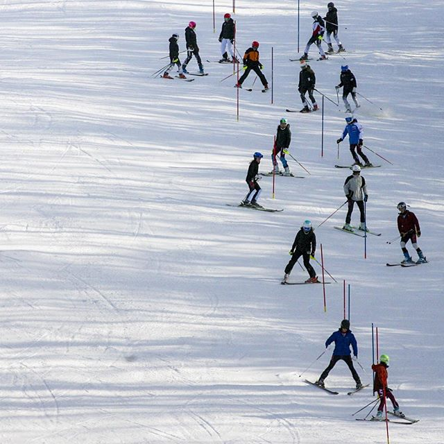 Playing follow the leader, members of the Berkshire League ski teams learn the slalom course set up on the Gunbarrel slope at Ski Sundown Wednesday afternoon. The Birkshire Ski League are private high schools from western Connecticut.  MICHAEL McANDREWS | mmcandrews@courant.com