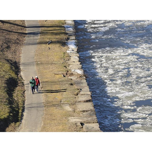 (L to R) Binh and Sithuy Nguyen go for their daily walk along the Connecticut River Thursday afternoon as ice flows past. The recent cold temperatures have started to freeze the slow moving river, the photo was taken from the Charter Oak Overpass.  Photo by JOHN WOIKE | woike@courant.com