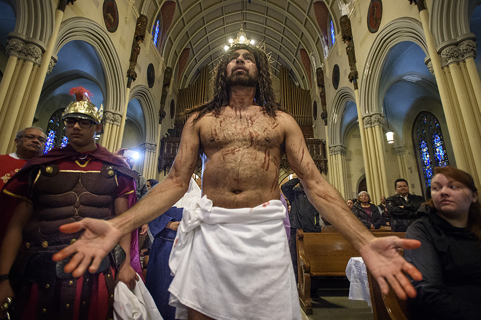 03.25.2016 - Hartford, Ct. - Julio Torres, as Jesus, holds open his palms as he is disrobed in preparation for crucifixion during the Stations of the Cross service at Our Lady of Sorrows. Photograph by Mark Mirko | mmirko@courant.com