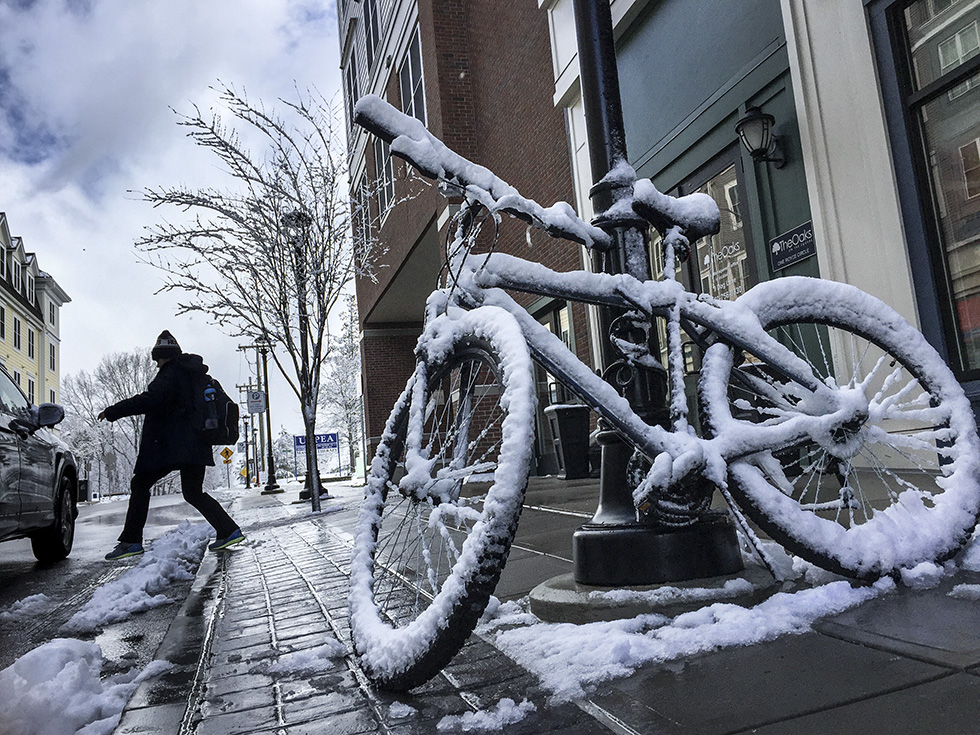 04.03.2016 - Mansfield, Ct. - A locked bicycle rests against a light post on Dog Lane in Storrs covered in the morning's snowfall. Photograph by Mark Mirko | mmirko@courant.com