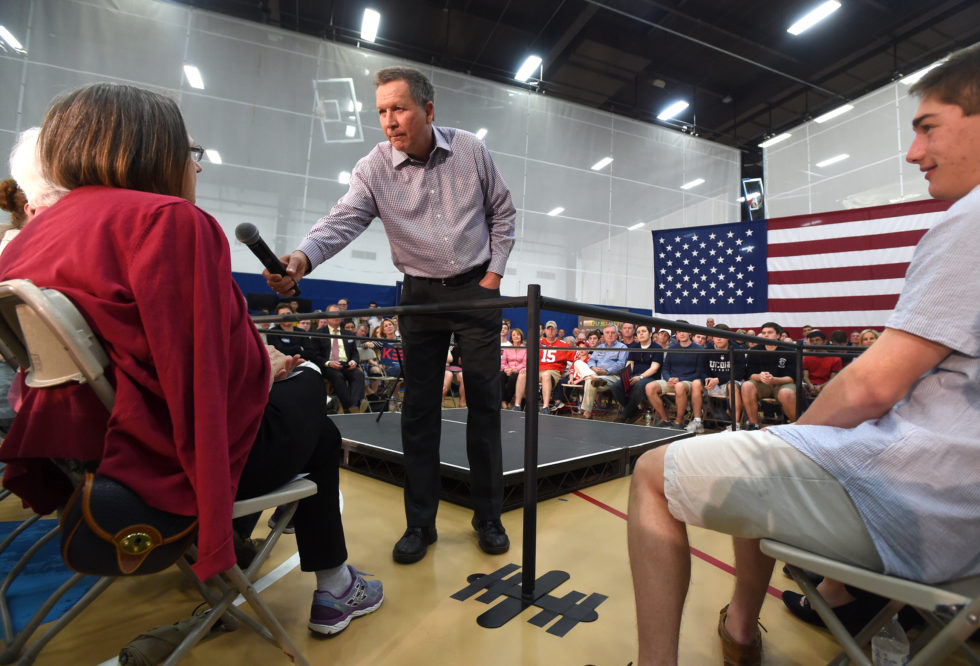 Glastonbury, CT - 4/22/16 - Republican presidential candidate and Ohio Gov. John Kasich addresses a member of the crowd at a town hall meeting at Glastonbury High School Friday evening. Photo by BRAD HORRIGAN | bhorrigan@courant.com