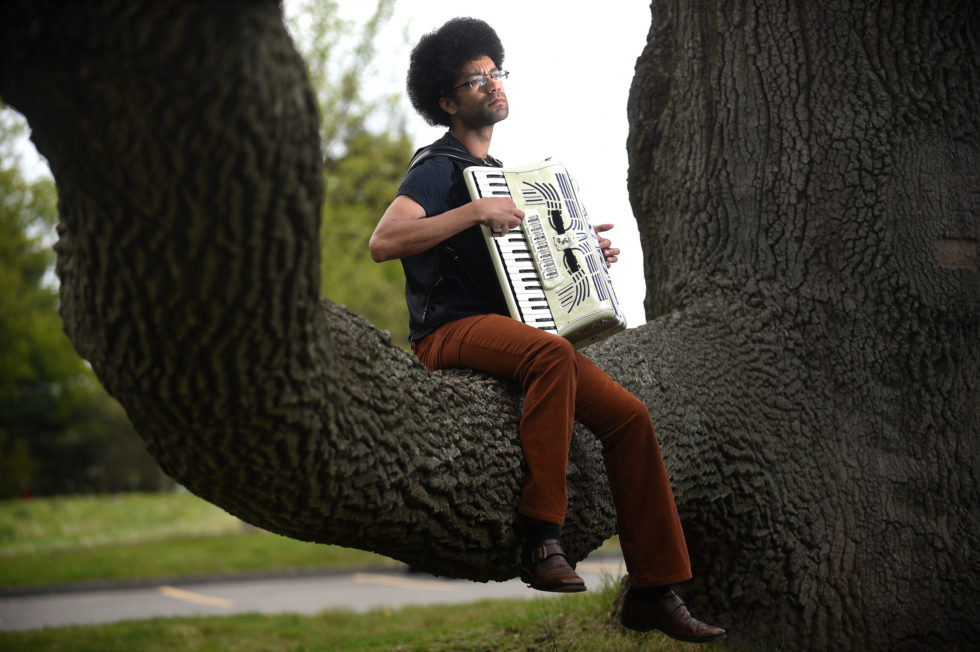 New Haven, CT -  4/29/16 - Accordion Adam Matlock plays on Science Hill in New Haven. Photo by Brad Horrigan | bhorrigan@courant.com